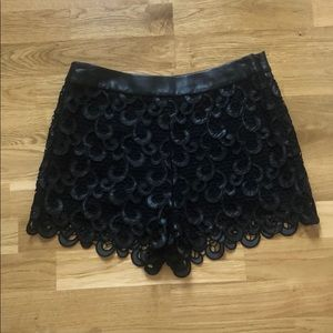 Endless rose leather and lace shorts